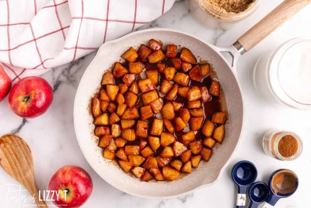 overhead view of skillet with cinnamon apples