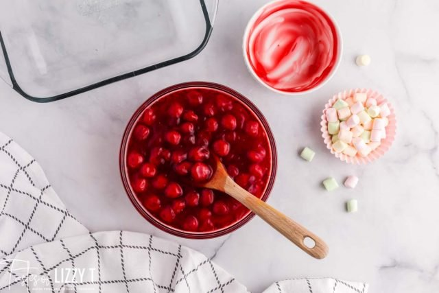 cherries and jello in a bowl
