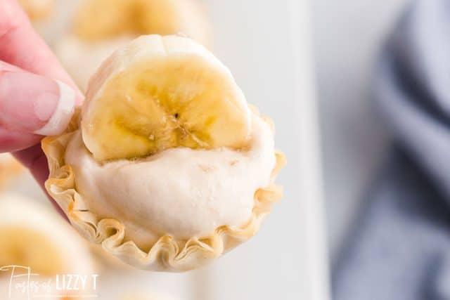hand holding a banana cheesecake