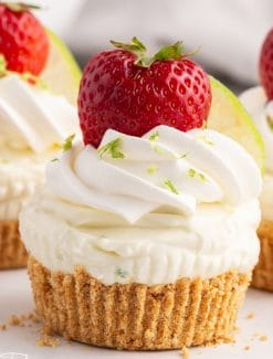 closeup of a lime cheesecake with strawberry on top