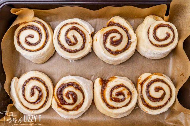 unbaked cinnamon rolls in a pan