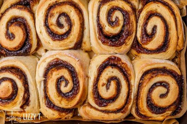 unfrosted cinnamon rolls in a pan