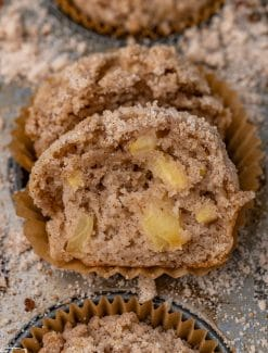 apple muffins in a baking pan with streusel