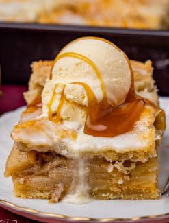 a piece of apple pie bar with ice cream and caramel