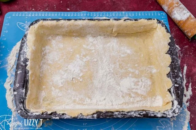 pie dough stretched in a 9x13 pan