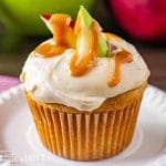 a cupcake with apples sitting on a plate