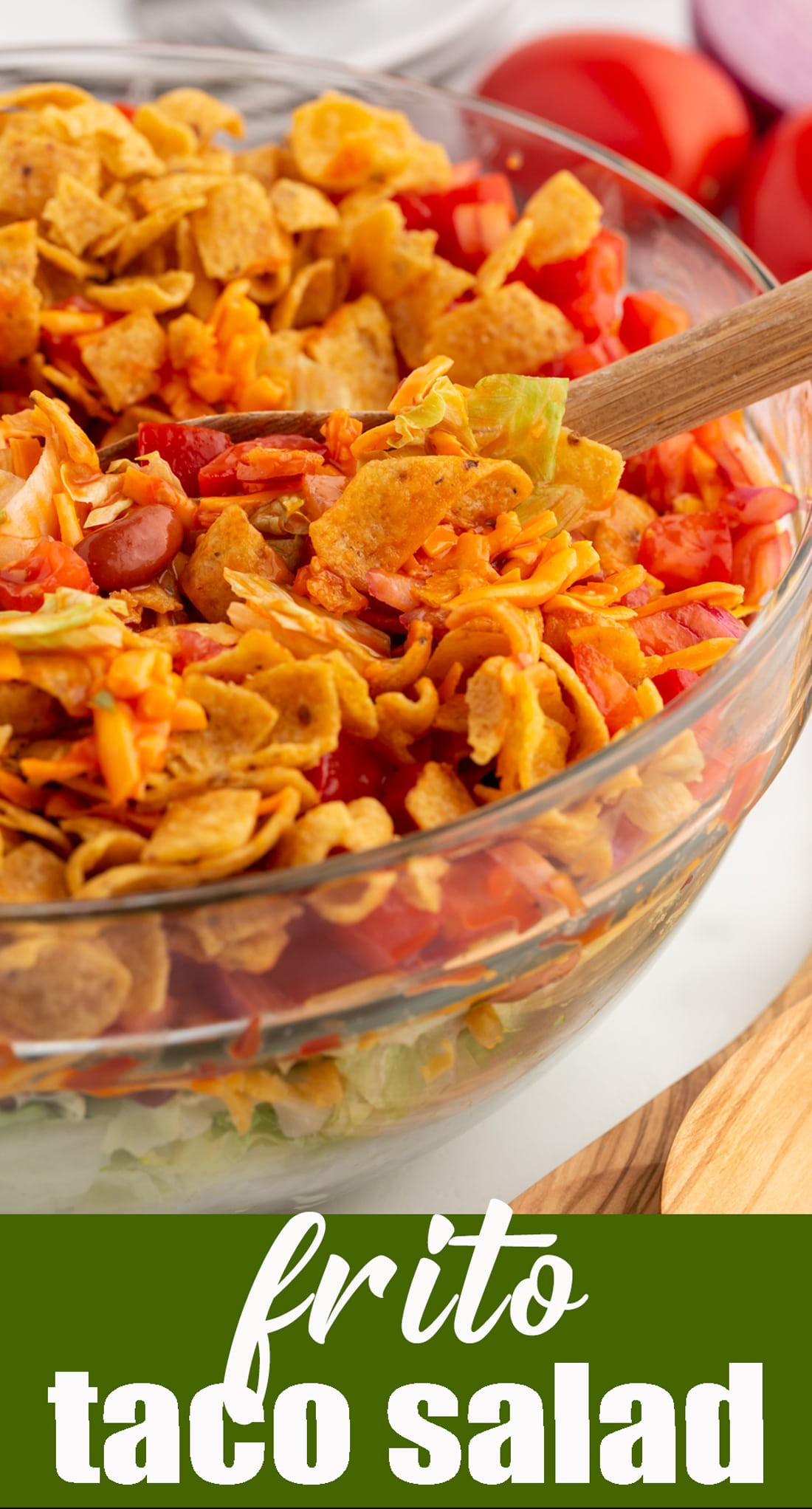 This easy vegetarian Frito Taco Salad is full of tomatoes, onions, cheese, lettuce and beans and has crunchy Fritos mixed in. via @tastesoflizzyt