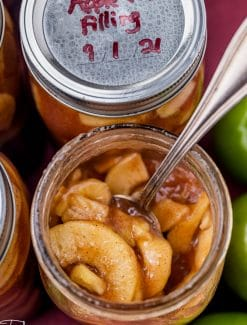 two jars of apple pie filling, one closed and one open