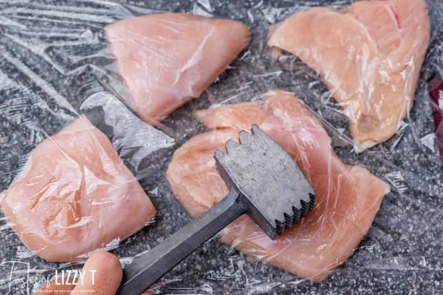 meat mallet pounding chicken breasts flat