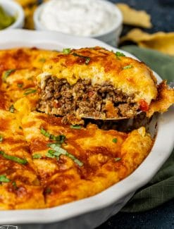 a slice of impossible taco pie on a spatula