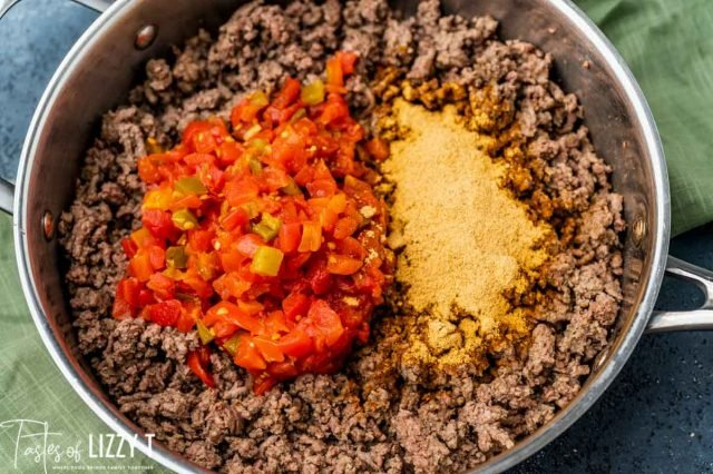 ground beef, seasoning and rotel in a bowl