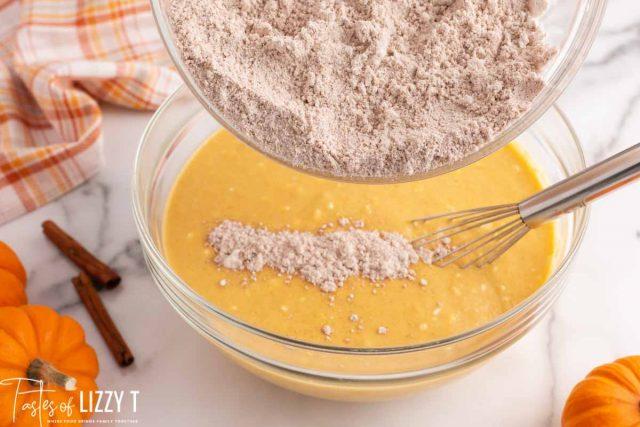 adding flour to pancake batter