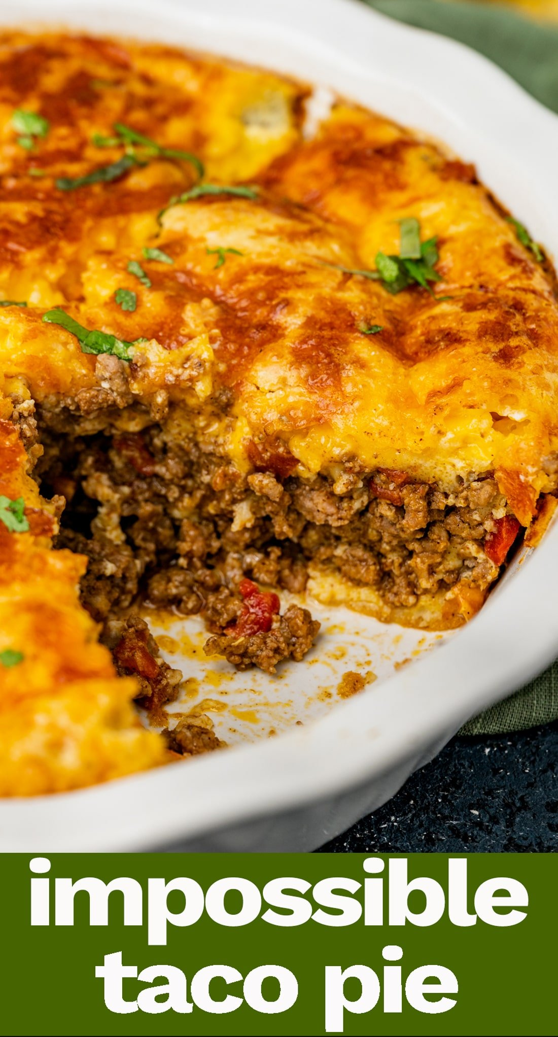 The ultimate in comfort food, this Impossible Taco Pie is layered with ground beef, Rotel, cheddar cheese and a Bisquick topping. It's an easy family dinner recipe. via @tastesoflizzyt