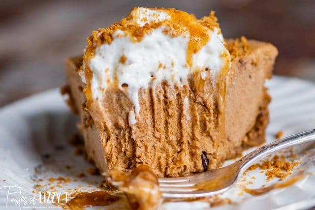 a piece of no bake pumpkin pie with a bite out
