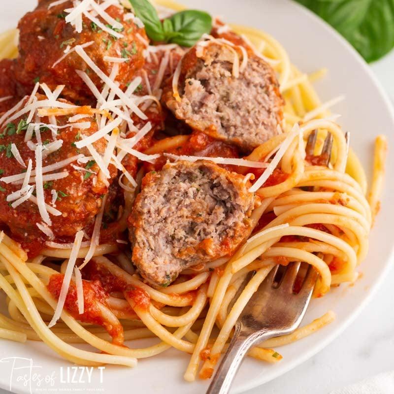 homemade italian meatballs over spaghetti