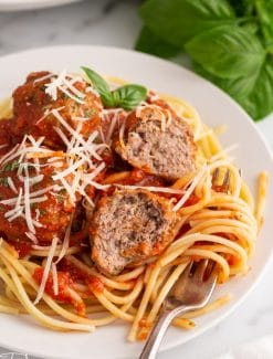 a plate full of spaghetti and meatballs