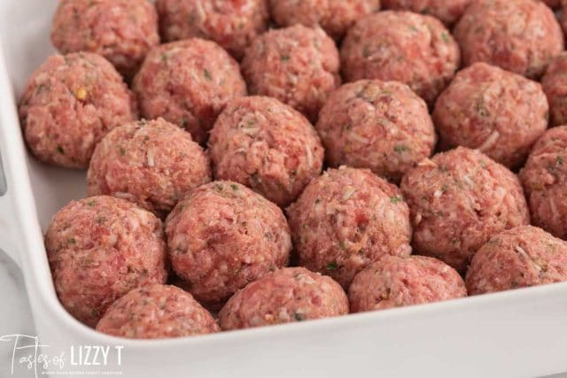 unbaked meatballs in a pan