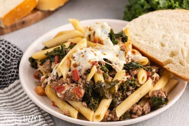 a plate of kale tomato skillet lasagna with bread