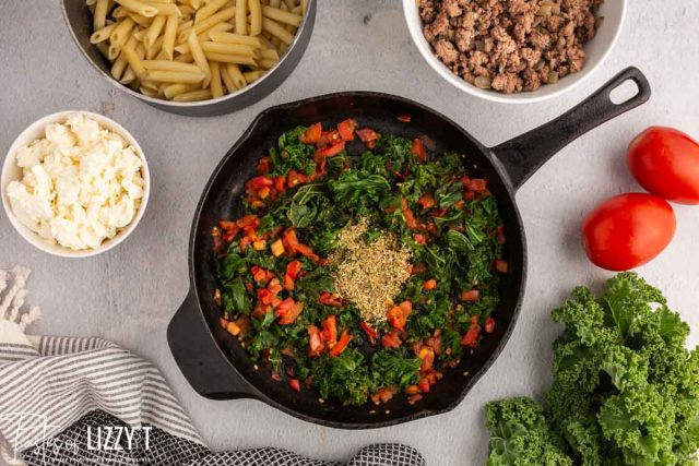 kale and tomato in a skillet