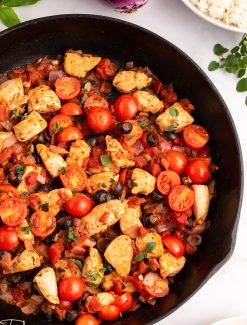 chicken and tomatoes in a skillet