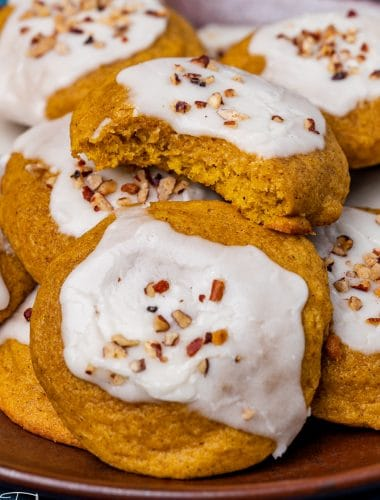 a plateful of soft pumpkin cookies with icing